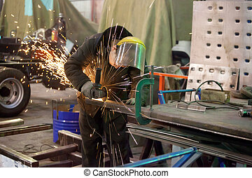 metall work shop - Worker works in a metall work shop