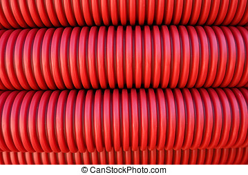 Rolled electrical conduit - Abstract bckground of rolled red...