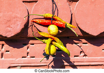 spices hanging at the facade as a donation to godness