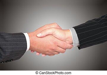 Business handshake deal - on grey gradient background