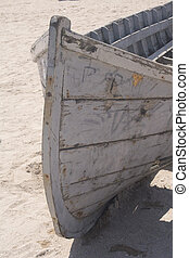 Abandoned fishing boat on sand