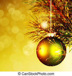 Xmas decoration ball over abstract golden backgrounds with...