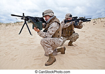 US marines in action - two US marines aim at different...