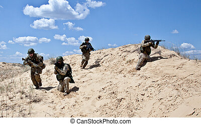 Move Move - Squad of soldiers run through the desert through...