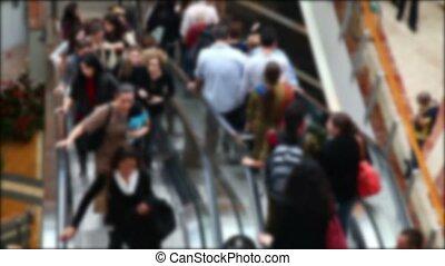 Shopping mall escalator (no focus)