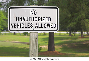 No Unauthorized Vehicles Allowed - A sign stating No...