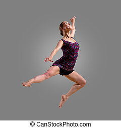 dancer jumping on a gray background, having a fun