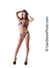 pretty young brunette woman posing in lingerie