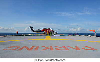 Helicopter park on oil rig - The helicopter refueling on oil...