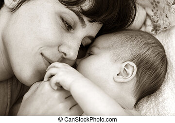 tenderness and love of mother to the child