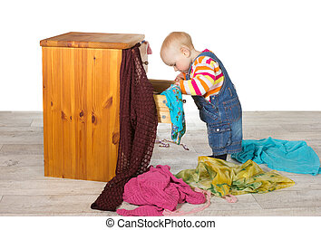 Happy baby unpacking clothes - Happy baby standing searching...