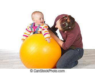 Devoted mother exercising her baby - Devoted mother...