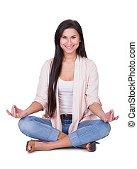 Serene beautiful woman meditating - Serene beautiful woman...
