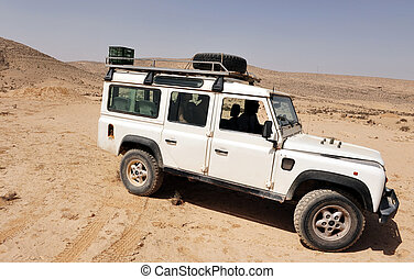 Four-wheel drive - A 4x4 car drive in the desert.