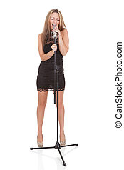 Beautiful female singer with a microphone isolated on white