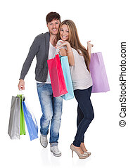 Guy and gal brings shopping bags in variety of colors