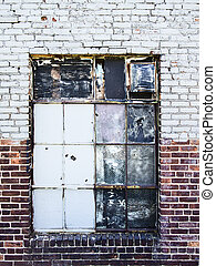 Gritty Warehouse Window - A boarded up window with broken...