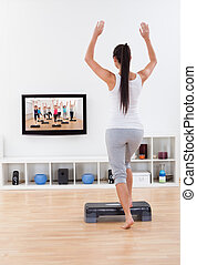 Athletic woman doing home exercises
