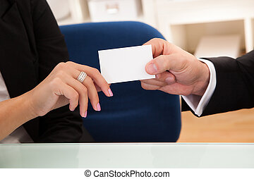 Man handing over a business card - Cropped image of the...