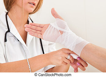 Sprained right hand treated by trained person