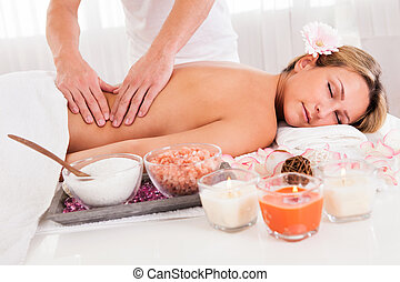 Client relaxing in massage parlor - Client relaxing in...