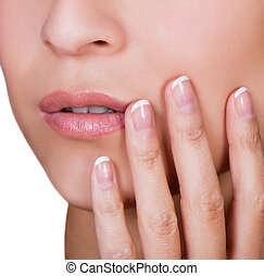 Woman with beautiful manicured finger nails covered in...