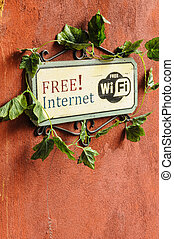 Free Internet sign on redish brown wall