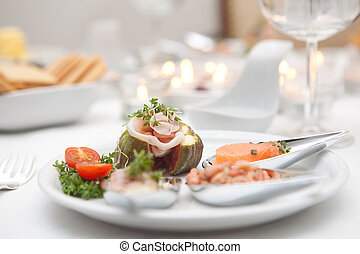 Gourmet starter dish with fancy seafood on silver spoons