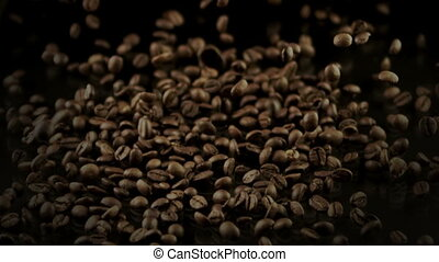 coffee beans falling on black table