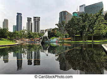 Reflection - A reflection of modern buildings in KLCC park,...