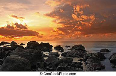 The Cove Sunset - Chesil beach cove at the Portland end of...