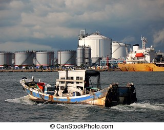 Oil Storage Tanks - -- a scene from Kaohsiung Harbor with an...