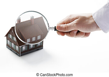 Magnifying glass and house. - Concept image of a home...