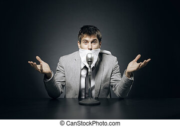Censorship - Young businessman with censorship gag on his...