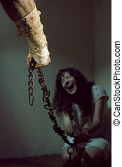 Young Woman in Chains - Chained slave woman, prisoner of an...