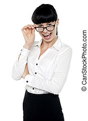 Cheerful business lady checking you out