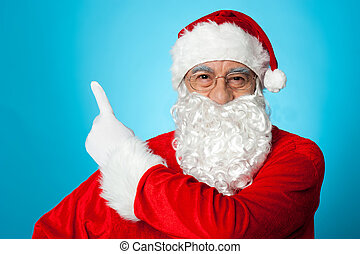 Father Christmas pointing away, copy space area - Father...