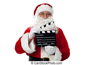Cheerful aged Santa posing with a clapperboard