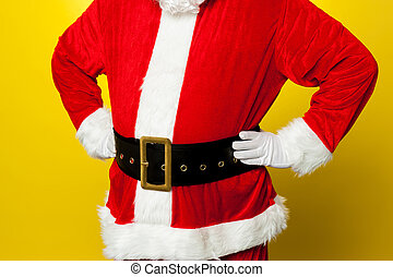 Cropped image of Santa resting his hands on waist