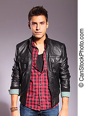 man in leather jacket and jeans