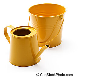 backet and watering can - Yellow backet and watering can of...