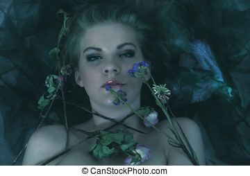 Rebirth - Woman with wilting flowers, rebirth concept