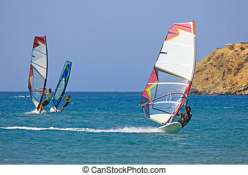 Windsurfer at Prassonissi beach - Sport, fun, enjoyment in...