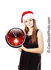 smiling christmas girl holding oclock over white
