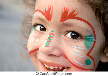 Little Girl With Face Paint Looking Up - A close up of a...