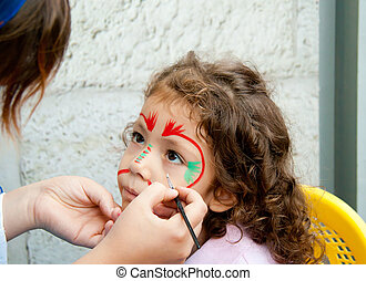 Little Girl Getting Her Face Painted - By An Artist At A...