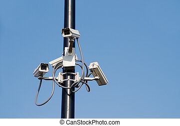 Security Cameras - A series of security cameras on a pole.