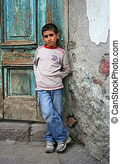 a boy standing at doorste - a cute boy standing at doorstep