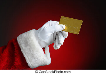 Santa With Gold Credit Card - Santa Claus hand holding a...