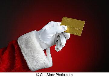 Santa With Gold Credit Card - Santa Claus hand holding a...